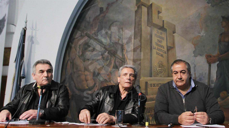 Los líderes de la CGT, Carlos Acuña, Héctor Daer y Juan Carlos Schmid.